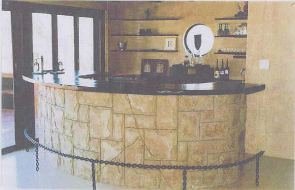 Curved bar with cladding